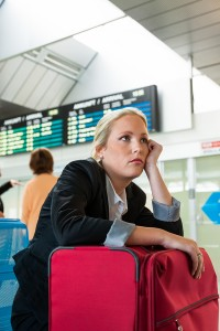business woman waiting for her departure at the airport. symboli